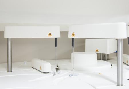 automate: Close up science laboratory test tubes  laboratory equipment.White automate chemistry analyzer.
