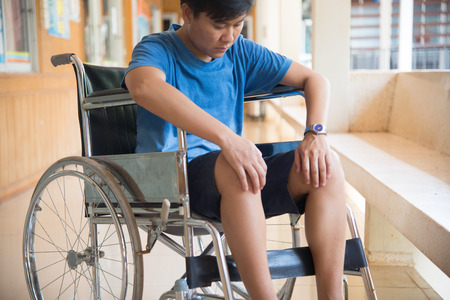 disablement: patient in wheelchair parked in hospital with selective focus.