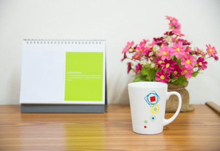 flowers with coffee cup on workspace.happy every time concept.
