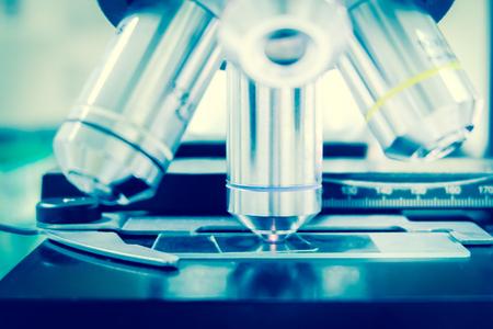 Laboratory Microscope. Scientific research blue background.
