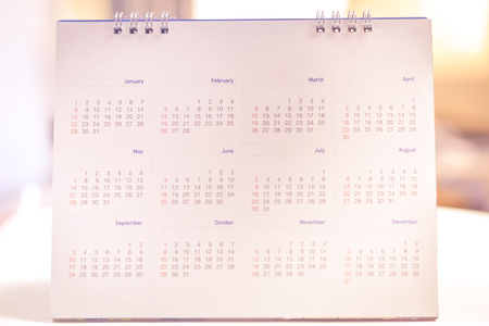 yearly: Blurred calendar page in smooth tone.
