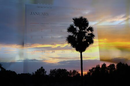 yearly: Double exposure Calendar with sunset on nature background.
