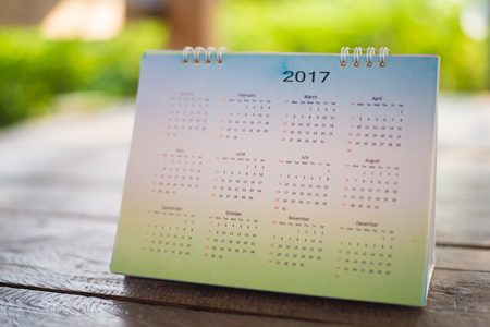 Calendar on green background. Stock Photo