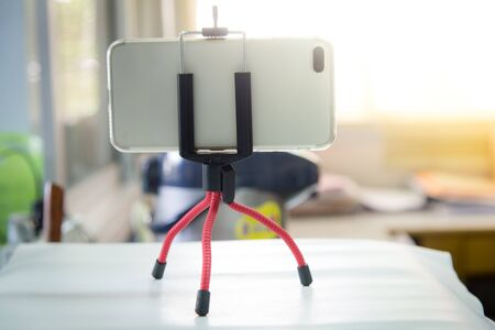 smartphone on mini tripod