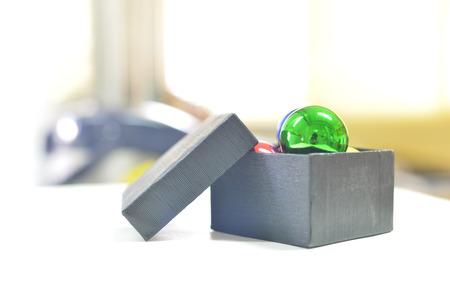 Ball on box on blur background.