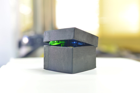 gumballs: Ball on box on blur background.