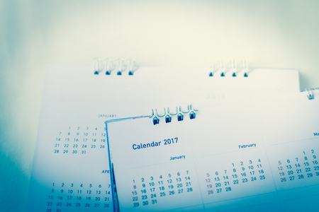 Blurred calendar on white texture.blue tone.