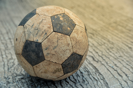 Old soccer ball on fall Stock Photo