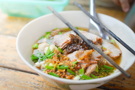 Thai noodle in bowl on the wood tebale.