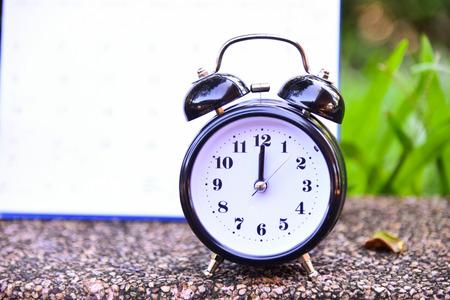 Close up vintage clock on blur background.