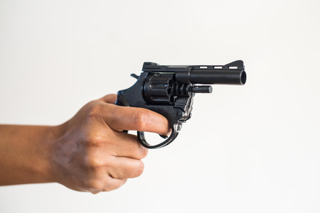Hand shooting gun on white background killer concept.
