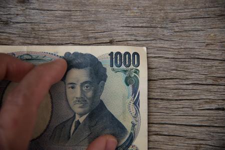 Close up Yen money on wood texture. 版權商用圖片