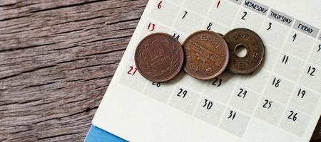 yen notes and yen coins with calendar in save money concept.