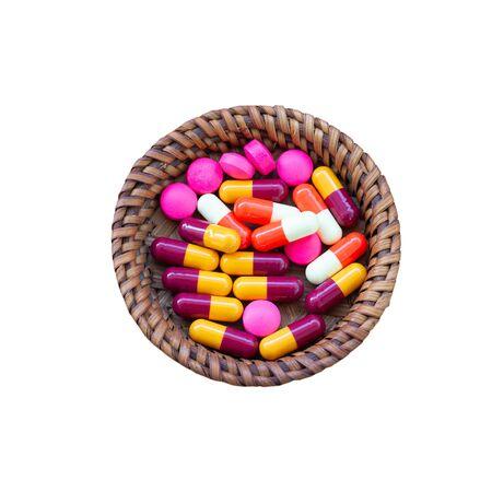 MIxed pills on isolate white backgroun.