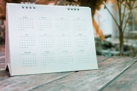 Blurred calendar on table in the garden.Planning concept. Banque d'images