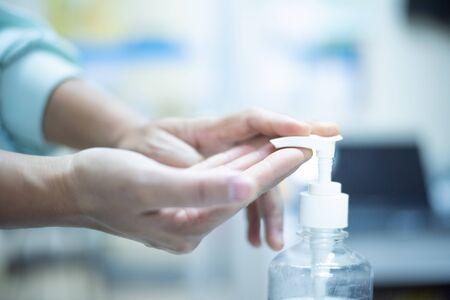 Close up hand using alcohol gel.Protecting coronavirus concept.