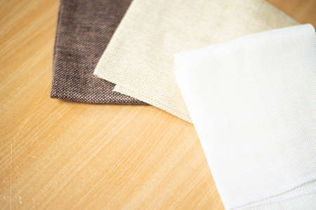 Group brown fabric on wood table.
