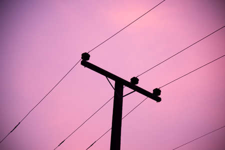 Electric pole silhouette on sky background. Stock Photo