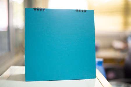 Close up on blank calendar in office. Foto de archivo