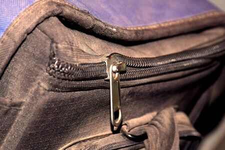 old bag with open zipper