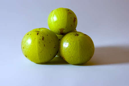 ripe gooseberry, and white paper in the