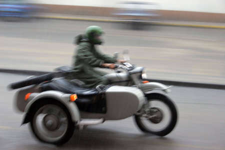 recluse: Motorcyclist in the motorcycle combination rain Stock Photo