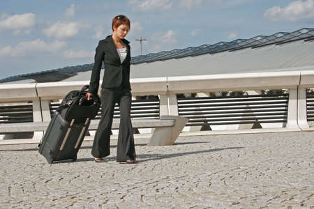 Woman leaving travels from there with her luggage