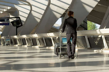 casters: Woman leaving travels from there with her luggage