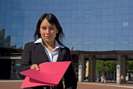 quoted: Businesswoman downtown holding a file Stock Photo