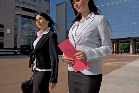 two young people businesswoman going town suit photo