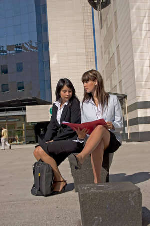 quoted: Portrait of two students looking at a file together Stock Photo