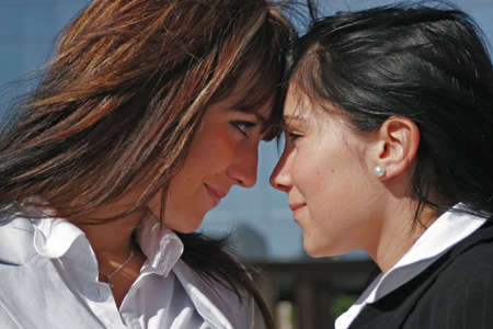 facilitated: Portrait of two young women being opposed Face to face