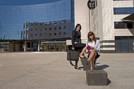 Businesswoman downtown holding a file Stock Photo