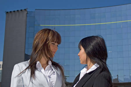 Portrait of two young women being opposed Face to face