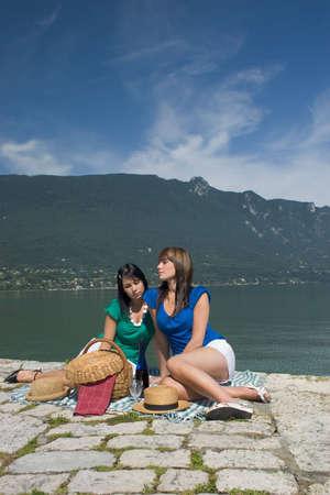 Woman making a picnic at the edge of a lake Stock Photo - 1171222