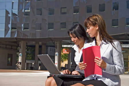 facilitated: Businesswoman downtown holding a file Stock Photo