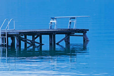 arise: Diving board on the edge of a calm water level