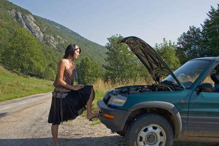 Woman breaking down of car