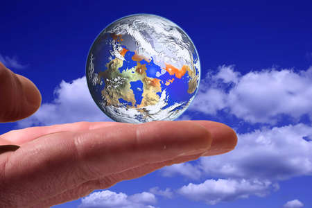 Holding the world on the hand Banque d'images