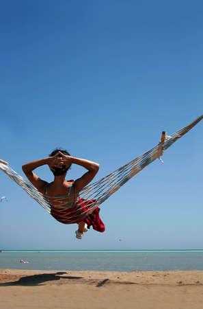 Woman in a hammock on a beach photo