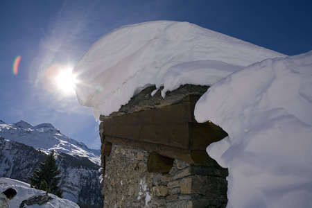 Chalet covered with snow in mountain during winter