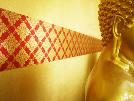 statuary: thai pattern graphic with golden background behind buddha statue Stock Photo
