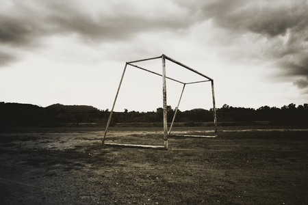 football goal post: View of old abandoned football goal post standing on field for concept of visual.