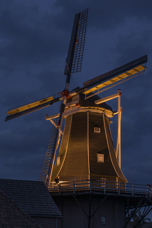 Authentic renovated windwill in Winterswijk in the east of the Netherlands in special winter illumination photo