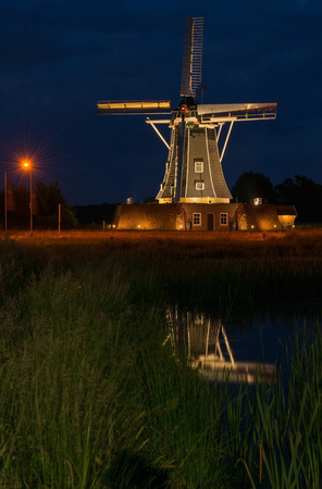 Winterswijk mill in Netherlands in the evening with special lighting photo