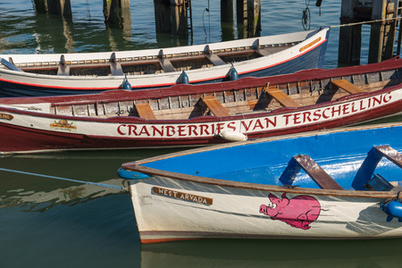 salazar: Colored rowing boats in the harbor of West Terschelling on the island of Terschelling in the Netherlands Editorial
