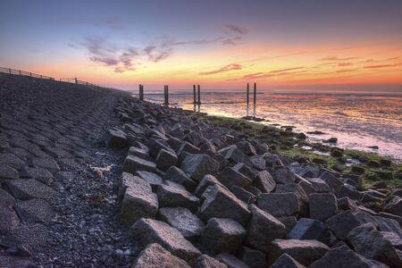 wadden: Wadden Island Terschelling Dyke at sunrise in the Netherlands Stock Photo