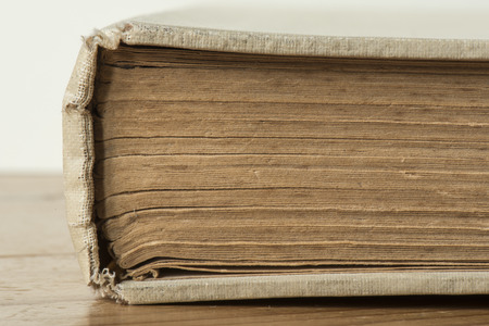 yellowed: Old antique yellowed book with no title on it Stock Photo