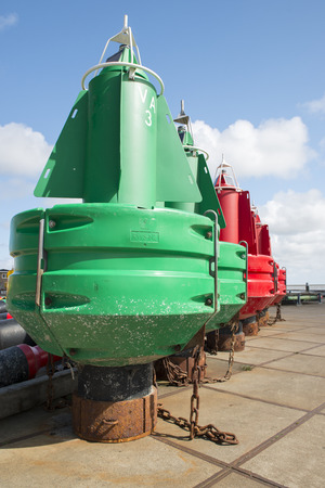 buoys: Colored navigation buoys in maintenance and storage