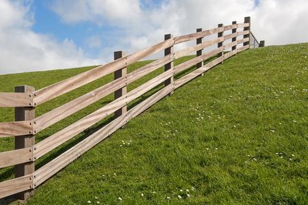 dyke: Wooden fence on a dyke
